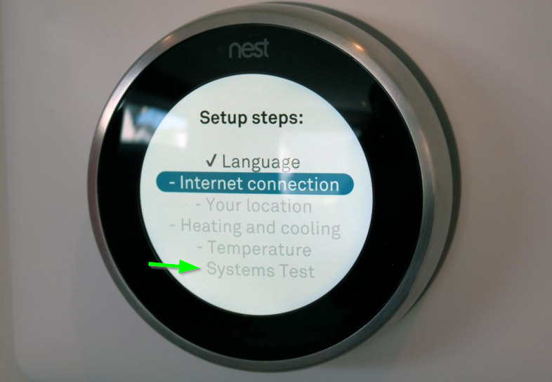 Nest thermostat with systems test highlighted