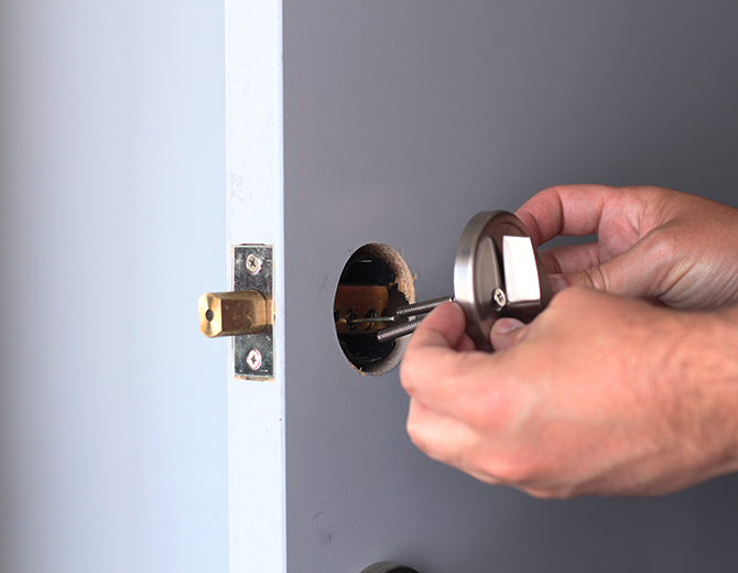 Removing the existing deadbolt. Illustration.