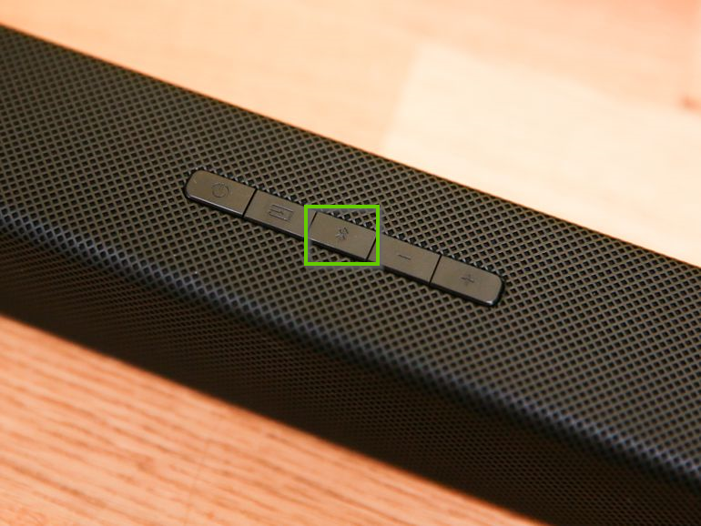 Soundbar buttons highlighting the Bluetooth button.