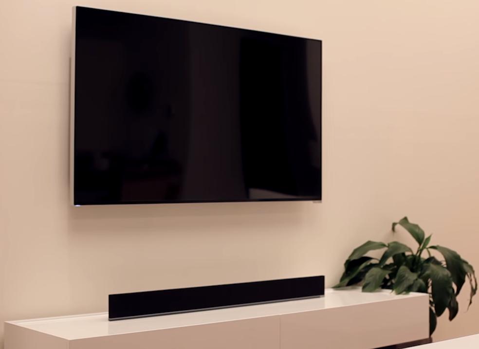 Soundbar placed beneath a television.