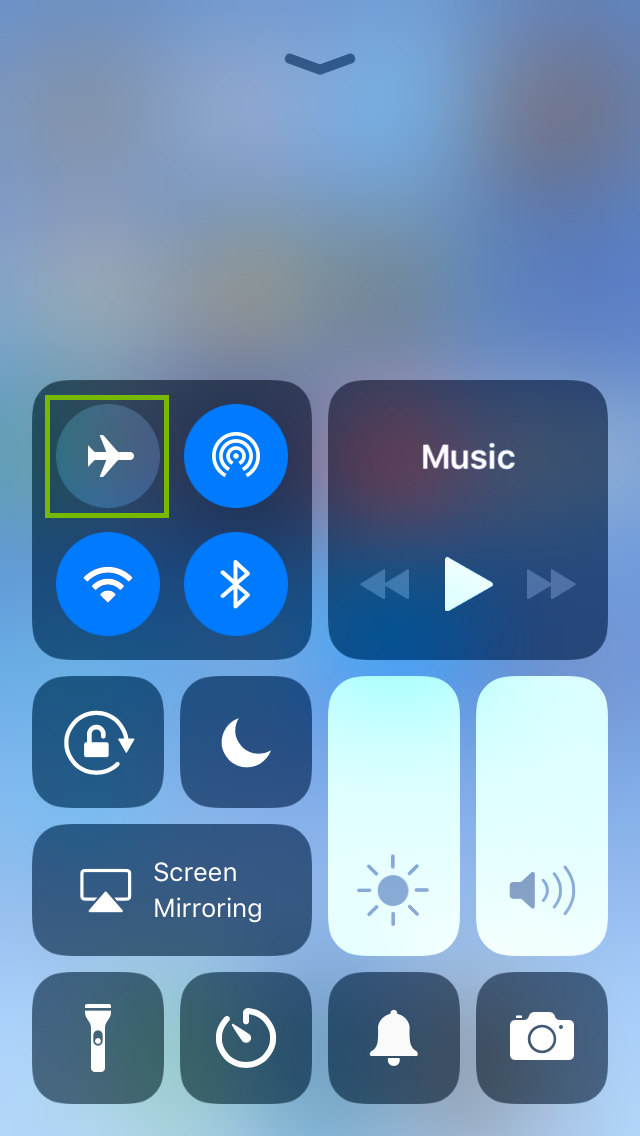 iPhone control center highlighting the airplane mode icon being disengaged.