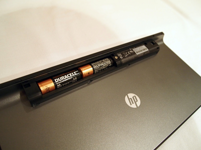 HP keyboard showing the batteries in the back