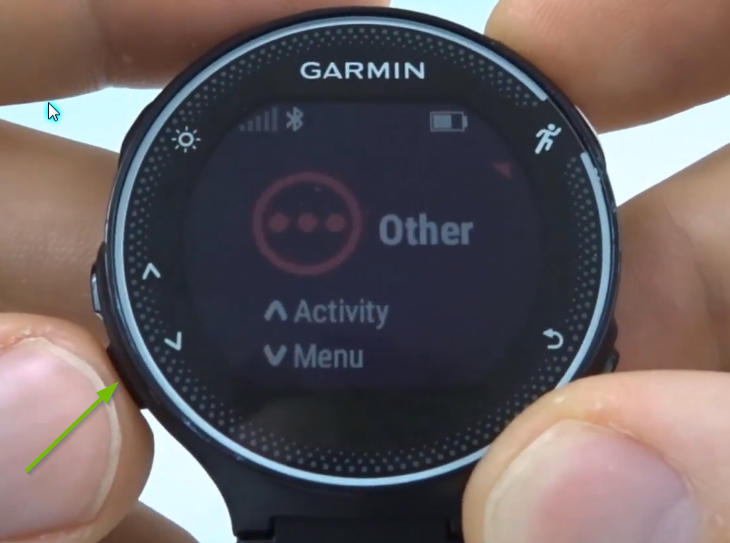Garmin Forerunner with down arrow button selected.