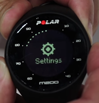 Polar M200 device displaying the settings option on-screen.