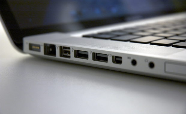 Photo of the USB ports on the side of a MacBook.