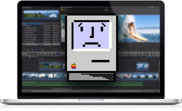 Stock photo of an Apple Macbook displaying the sad mac logo.