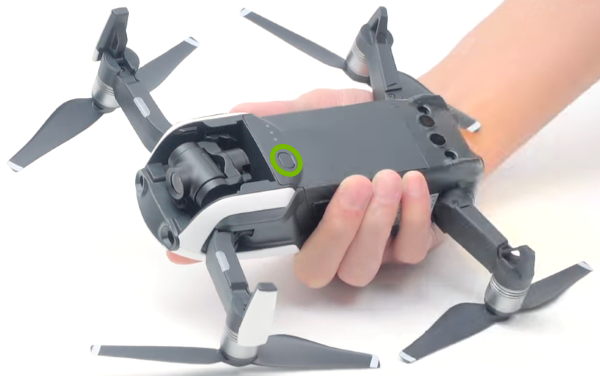 Power button highlighted on bottom of drone.