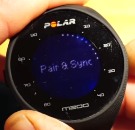 Polar M200 device displaying the pair and sync option on-screen.