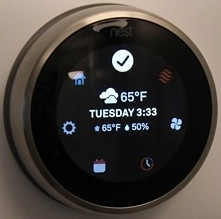 Nest thermostat displaying the quick menu.