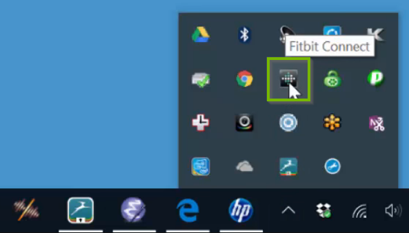 Windows 10 system tray highlighting the FitBit app icon.