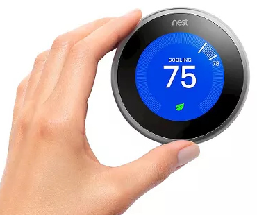 Nest thermostat ring being turned.