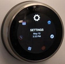 Nest thermostat quick menu ring highlighting the settings icon.