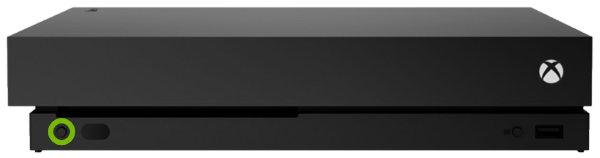 Eject button highlighted on front panel of Xbox One X.