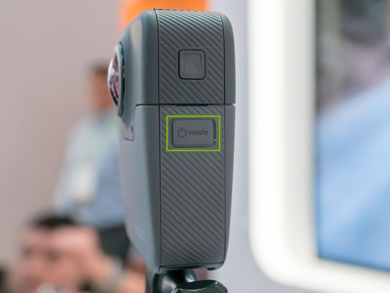 GoPro Fusion camera with Mode button highlighted on the side.