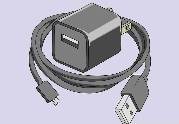 Image of a USB cable and USB wall charger being inspected for defects