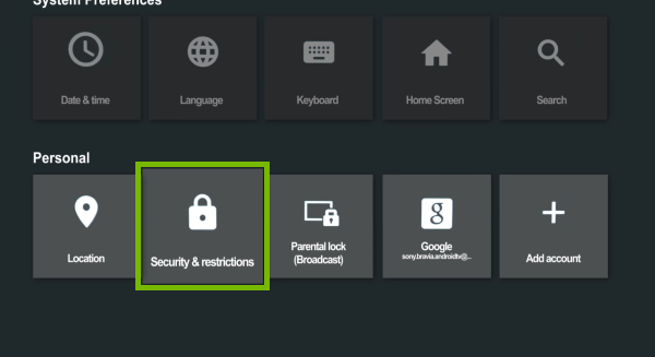 Security & restrictions options highlighted in Android TV settings.