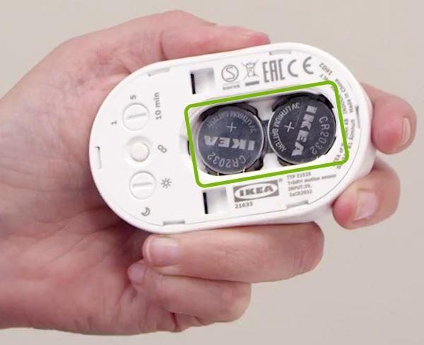 Batteries inserted in IKEA Tradfri motion sensor.