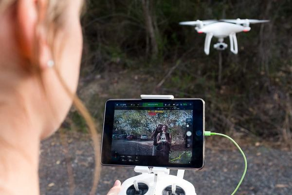 Drone being piloted with remote control.