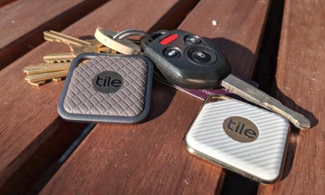 Tile affixed to a set of keys.