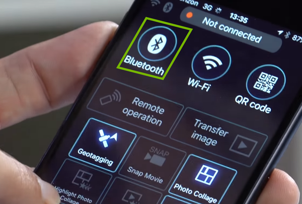 Bluetooth option highlighted on phone screen.