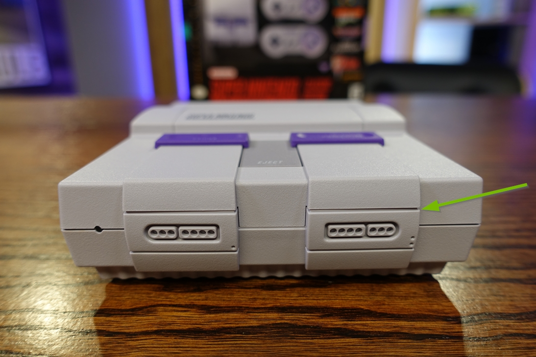 Photo of the SNES Classic Edition highlighting the front controller port cover while closed.