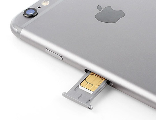 iPhone with a sim card being inserted.