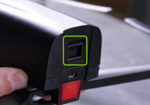 Latch on drone battery highlighted.