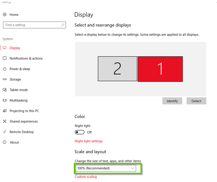 A windows 10 settings screen with display tab selected. 100% size of text, apps, and other items is highlighted.