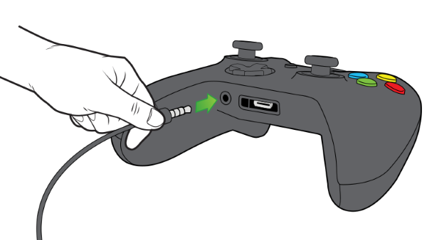 Chat headset being plugged into controller.