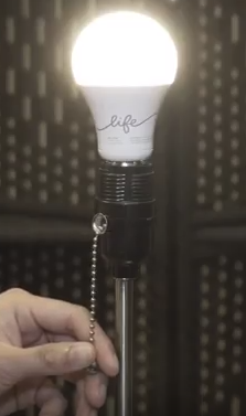 A c-life bulb being turned on.