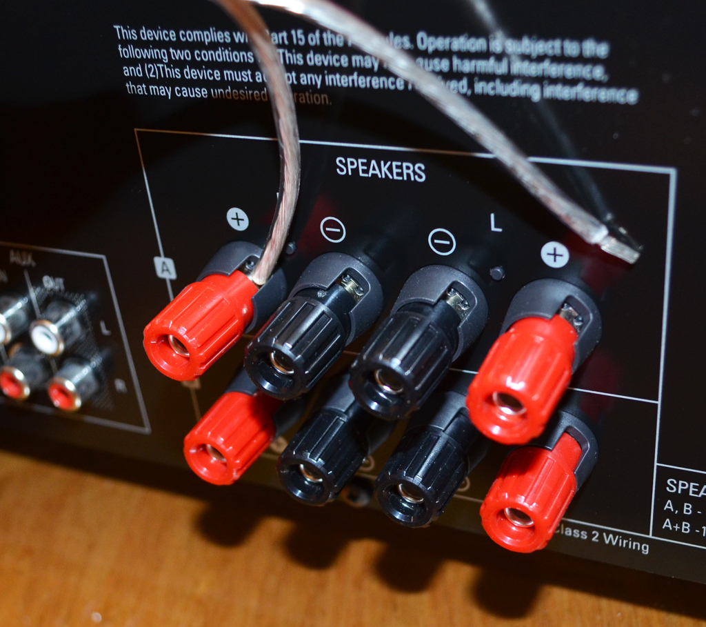 Speaker wire connections using binding posts. One wire has come loose.