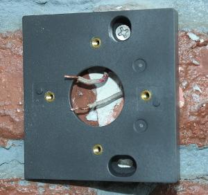 Screwing into the doorbell wedge