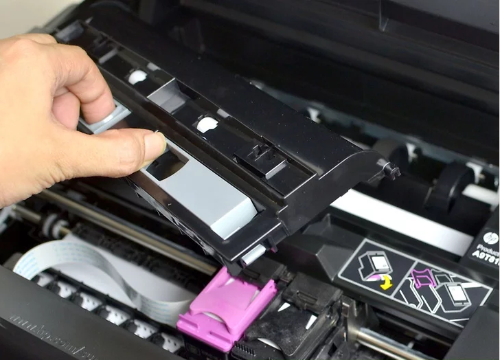 Photo of a printer's removable rear access door.