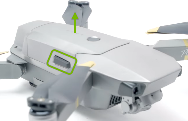 Battery side buckle highlighted and arrow pointing release direction.