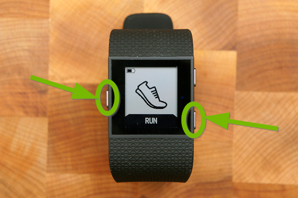 Fitbit Surge with Home and Select buttons highlighted.