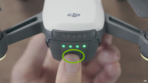 Drone with power button highlighted. Illustration