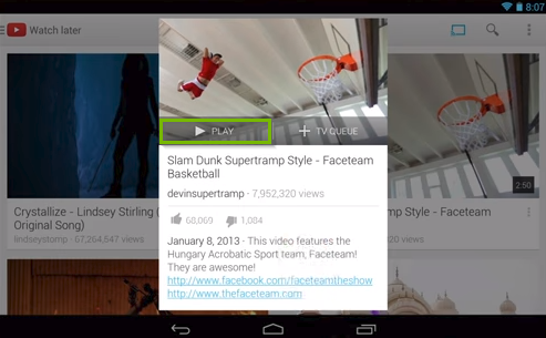YouTube app displaying a video's informational screen highlighting the play button.