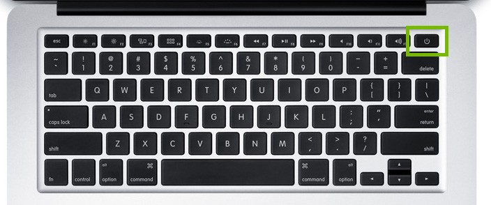 Macbook power button highlighted on the keyboard.
