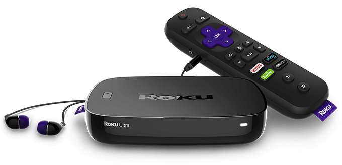 Roku Ultra with remote control and earbuds.