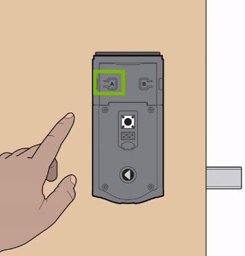 Reset button location highlighted on door lock