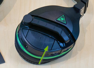 Power button pointed out on the Turtle Beach Stealth 700 headset.