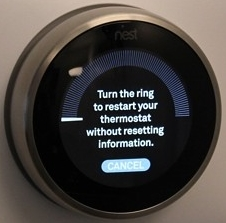 Nest thermostat reset prompting the user to turn the dial to confirm their choice.