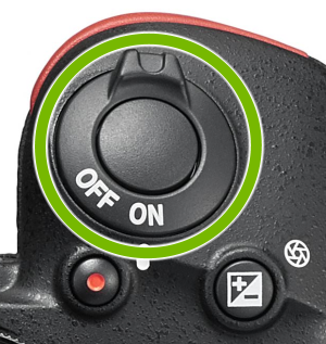 Power switch highlighted on top of Nikon camera.