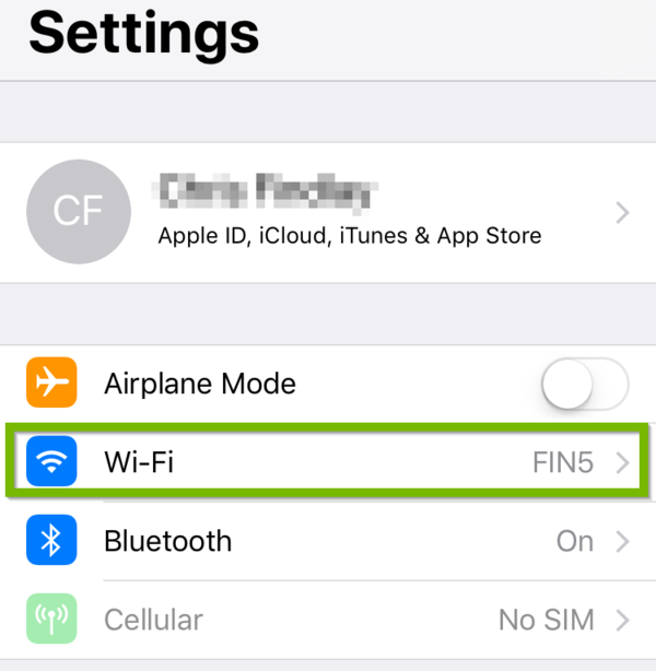 iOS Settings with Wi-Fi highlighted.