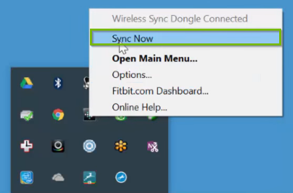 Windows 10 system tray displaying the right-click menu for the FitBit app with sync now highlighted.
