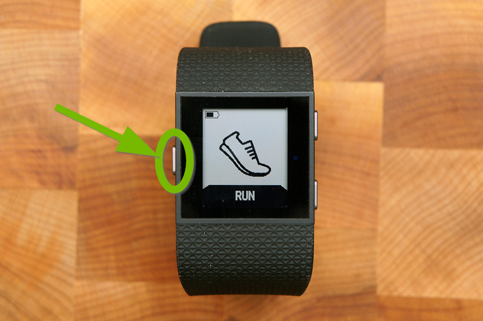 Fitbit Surge with Home button highlighted.