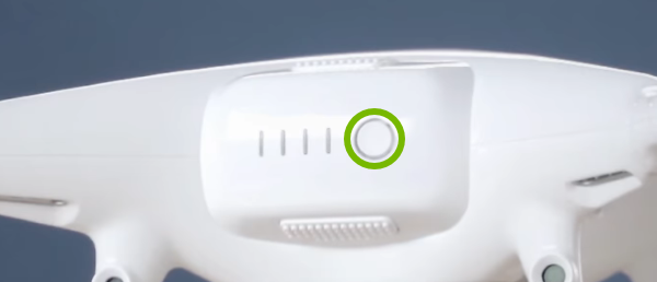 Power button highlighted on rear of drone.