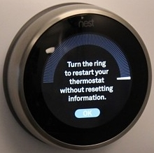 Nest thermostat dial has been turned and is prompting the user to select OK.