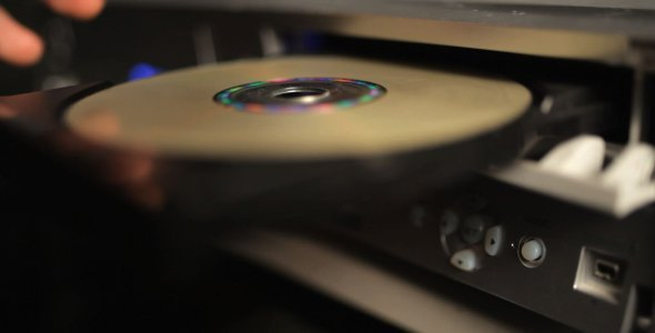 Inserting a disc into a CD or DVD tray. Illustration.