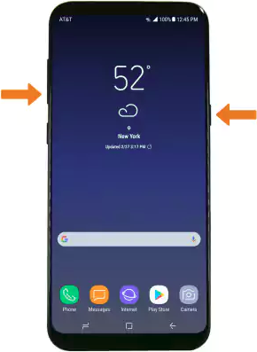 Smartphone with Power and Volume down buttons held down.